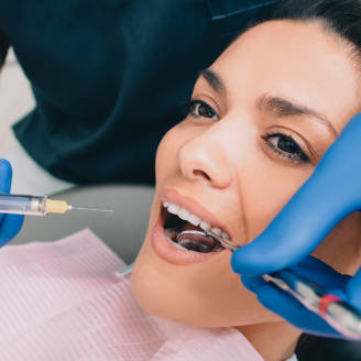 Bezbolesne leczenie w Centrum Stomatologicznym New-Dent